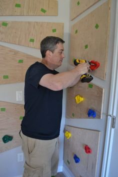 Do It Yourself Climbing Wall Kids climb walls. So why not give them one they are allowed to climb? Here is how to build an awesome diy indoor climbing wall. Indoor Climbing Wall, Kids Climbing, Rock Climbing, Toddler Climbing Wall, Kids Indoor Playhouse, Indoor Gym, Indoor Jungle Gym, Kids Gym, School Kids
