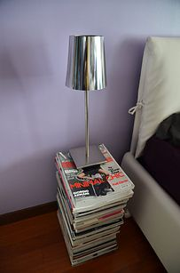 NEW USES FOR MATERIAL: People use a stack of magazines as a side table because it can be thick enough.