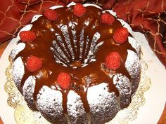 Chocolate/Raspberry designer Bundt Cake Made with Chambord and decorated with fresh Raspberries
