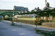 Brand new Brush Type 4 Co-Co no. D1890 is bathed in the evening sun as she comes through Rotherham Masborough on an up freight on 3rd August 1965. Would later become 47371, then 57313. Still in service in 2014, owned by West Coast Railways.