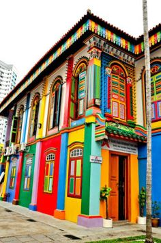 """This beautiful colorful building is located in little India, Singapore. The architecture is very vintage looking, however the colours do give a modern and """"summery"""" vibe. These summer colours go well with Singapore's hot weather. Colourful Buildings, Beautiful Buildings, Beautiful Places, Colorful Houses, Unusual Buildings, Colourful Art, Beautiful Streets, Amazing Places, Little India Singapore"""