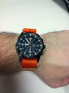 Seiko SND65 (43.5mm) on a 22mm Maratac Mil Series NATO G10 International Orange. Retails for 315.00 USD discounted to 155.00 plus NATO. A review of this watch can be found here: http://wornandwound.com/2011/07/18/review-seiko-snda65/ Maratac straps can be purchased here: http://countycomm.com/nylonbands.html and here: http://www.broadarrow.net/maratac.htm