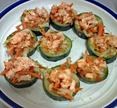 Stuffed Cucumber Bites (C1) Recipe Author: Becki EastonCucumber slices stuffed with cabbage, tomato, carrots and chicken on top