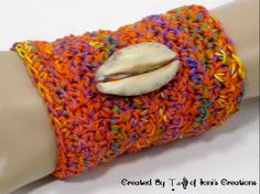 https://www.etsy.com/listing/124548112/kente-colors-4-crochet-cuff-with-large