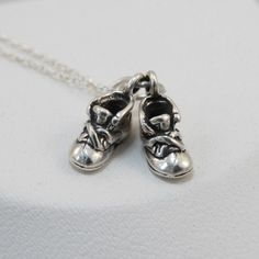 FashionJunkie4Life - Sterling Silver Pair of Baby Shoes Charm Necklace, $16.99 (http://www.fashionjunkie4life.com/sterling-silver-pair-of-baby-shoes-charm-necklace/)