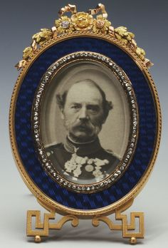 Fabergé frame with photograph of King Christian IX of Denmark. Gold and dark blue guilloché enamel; ivory back, workmaster Michael Perchin, 1893.