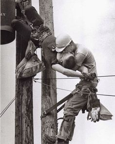 "Taken in 1967 by Rocco Morabito, this is one of the most powerful photographs we've seen. Called ""The Kiss of Life"" photo, it shows a utility worker named J.D. Thompson giving mouth-to-mouth to co-worker Randall G. Champion after he went unconscious following contact with a high voltage line."
