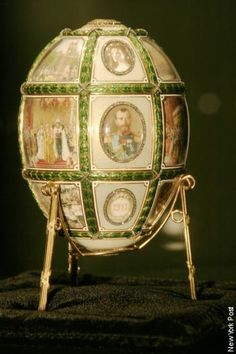 "Faberge Eggs Of The Czars  ""The Fifteenth Anniversary""  Delivered in 1911, it looks back on the 15 years since Nicholas II's coronation. It carries 16 miniatures, seven are portraits of the royal family. Presented by Tsar Nicholas II to Tsarina Alexandra Feodorovna on Easter 1911."