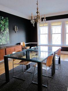 Vintage Modern Dining Room with Dramatic Dark Walls