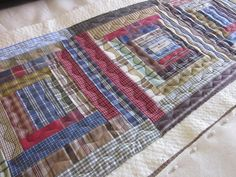 I was supposed to make Ryan a place mat for the end table next to the couch in the man cave.but I got distracted and made a table runner i. Quilting Ideas, Quilting Projects, Sewing Projects, Man Cave Quilts, Man Cave Table, Plaid Quilt, Homemade Quilts, Table Runner Pattern, Tablerunners