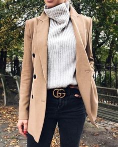 Camel blazer over white sweater and black jeans.
