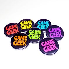 Geek badges perfect for all gamers! Available in seven different colours so that every member of your game group can pick the perfect colour to match their favourite player marker! Full Description: Printed Pin Badge Each badge measures approximately 32mm AVAILABLE COLOURS: Red, Orange, Yellow, Green, Turquoise, Hot Pink, Purple Designedby Laura Smith Made in... Green Turquoise, Pink Purple, Hot Pink, Geek Games, Button Badge, Pin Badges, Dungeons And Dragons, Different Colors, Markers