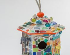 Mosaic Birdhouse with plastic safari and farm toys, plastic alien, buttons and other found objects + glass and ceramic tiles by Zorra Creative Fox Studio