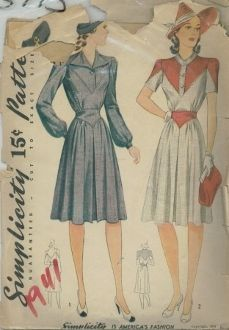 An original ca. 1941 Simplicity Pattern 3773.  This attractive frock has interesting details. The lower bodice is joined to a deep V yoke and the sleeves are capped with V shaped sections. In Style II, these oke effects are made of contrasting material. The neckline of Style I is finished with a rever collar and Style II has a collarless cardigan closing. The bodice and skirt are joined to a pointed waist yoke. The skirt is pleated at the center front.