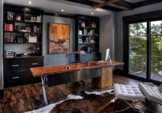 Dashing home office in gray with black shelves, cabinets and a live edge table [From: In Site Designs / Getz Creative Photography]