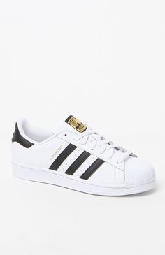 Better than basic, adidas presents the Black and White Superstar Sneakers  for a beloved classic look. A style adored for decades, these women's  sneakers ...