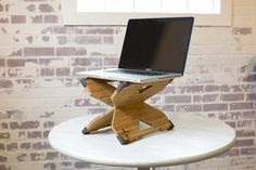 The X-Stand™ is a lightweight stand for your laptop that lets you turn any work surface into a standing desk.  Work YOUR way!