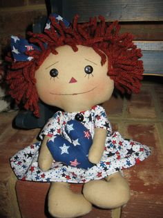 Small Patriotic Raggedy Ann by craftystitchers on Etsy.  If the link says it's sold....that's because I just bought it! (I couldn't resist)