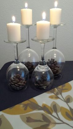 Quick, simple, and cheap fall table decorations. Pine cones from the yard, wine glasses from my collection, and 99 cent candles. Enjoy!