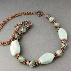 Necklace made of amazonite granite, amazonite and copper color fittings. Togl lock, length 60cm. Chain handmade, chain weaving. The set includes a bracelet and earrings. Decoration in a single copy, without repeats. Beads are very beautiful, bright, unusual.
