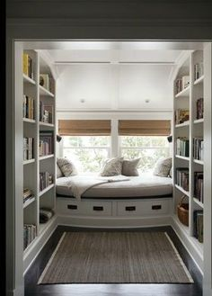White painted reading nook ... love the natural light, perfect place to curl up.