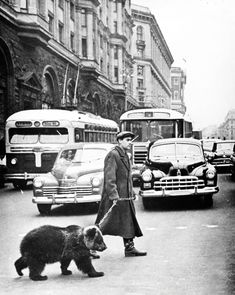 1963 Gregory Sukhov takes his pet bear Mickey for a walk in Moscow.  (via vintagegal)