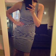 Striped dress Fits snug but has lots of stretch! Very flattering. Gently worn. Dresses