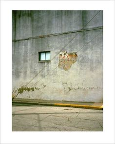 """Wall in Paris, Texas  """"If I had had a hammer,  I would have tried  to chip off more from that stucco  and uncover the entire precious fresco   underneath.  But I only had a camera."""""""