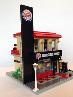 Hi, This is a Burger King drive through store I made for my friend who loves Whopper as well as modular series. Key aspects of real Burger King drive through stores I tried to represent in this work are 1) black signage with the logo on its top, 2) tan-colored simple walls, 3) roof with vivid red color and 4) drive through path and window. Interiors are designed as detailed as possible with 1) a modern style chandelier on the ceiling for both floors, 2) a kitchen with full equipments…