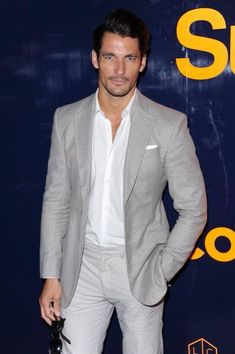 David Gandy attending the Superdry S/S 2015 event ahead of London Collections: Men June, 2015.  David is wearing a Lawson Walker blazer, Club Monaco trousers, and Cutler and Gross sunglasses. June 14, 2014. Photo source: Getty