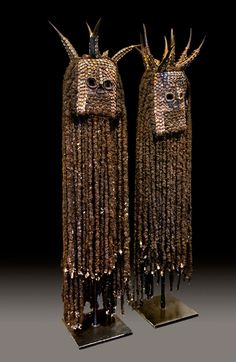 Africa | Masks from the Bamileke people of western Cameroon | Horn, hair, cowrie shells, wood and textile