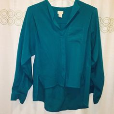 H&M Thick Chiffon Blouse Teal colored button up blouse. Loose fitting. All buttons in tact. Slight pull as pictured, extremely small but still thought I should mention it. Otherwise in good condition. H&M Tops Blouses