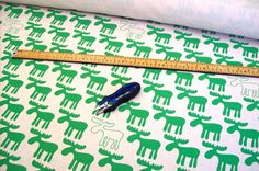 Moose hand screen printed fabric - green. By Mookah (Etsy)