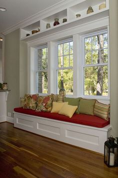 Window seat...love the built in shelf above
