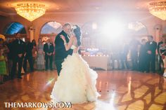 The Versailles Ballroom looks like it's glowing as the bride and groom dance together at the beginning of their wedding reception. www.VersaillesCaterers.com. Photo courtesy of Markow Photography. #wedding #bride #groom #marriage #VersaillesBallroom #njweddings #njbanquethall #tomsriver #nj #newjersey #weddingtheme #reception #weddingreception