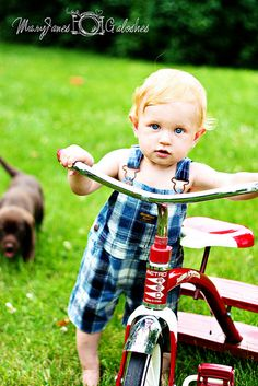 Sweet blue eyed boy! MaryJanes and Galoshes Photography #tricycle #bib overalls #Cute Kids