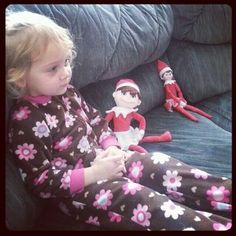 Mira hanging out with her new stuffed Elf toy that Twinkle brought for her this morning. Notice how the real Twinkle has to sit across the couch from Mira because she's upset that Twinkle is going back to the North Pole tonight. Poor kiddo. :-(