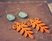 penelope.  a pair of orange and teal boho leaf earrings.