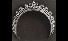 Halo Tiara.  Purchased by Prince Albert, Duke of York in 1936 for his wife, Princess Elizabeth, the Duchess of York.  It was later worn by their daughter Queen Elizabeth II, Princess Margaret, and Princess Anne.  The Queen loaned the tiara to Kate Middleton for her wedding to The Queen's grandson, Prince William.  22 July 2011.