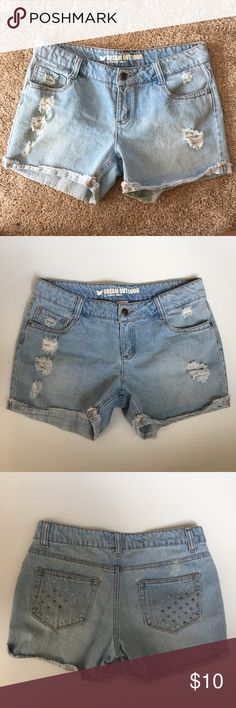 • Distressed Denim Shorts • Dream out loud by Selena Gomez distressed shorts, light wash, cutoff style. Two flaws noted in the photos, on the very edge of the hemline, & faded spot above back pocket. May be something that can be cleaned but not terribly noticeable. Great condition otherwise. Cute design on back pockets with studs.   •Measurements laying flat:   15 inches across waist   4 inch inseam   8 inch front rise   12.5 inch back rise Dream Out Loud Shorts Jean Shorts