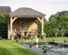 A gazebo with cedar shingle roof. Garden Buildings, Garden Structures, Outdoor Structures, Outdoor Cooking Area, Outdoor Entertaining, Garden Huts, Herb Garden, Outdoor Pavillion, Bbq Shed