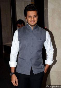 Riteish Deshmukh turns gentleman in a grey Nehru jacket, white shirt and black trousers. via Voompla.com