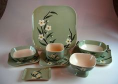 """Weil of California, in the """"Blossom"""" pattern. Weil produced popular dinnerware lines and artware in the 1940s-1960s. Features white and yellow dogwood blossoms handpainted on a green-gray glaze"""