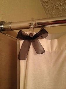 DIY Bathroom Ideas! Add bows to your shower curtain to add a little touch of femininity!