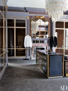 A luxe dressing room's chandelier complements the overmantel mirror | archdigest.com
