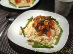 Fusilli with tomato sauce, peppers, capers, olives and asparagus
