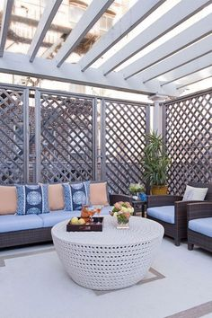 Create a serene outdoor space even in the middle of the city by adding trellises to create privacy. We love how these homeowners took it a step further and added stylish outdoor seating and pillows with pops of blue to connect the space with the interior. Click to shop all your favorite outdoor furniture on Wayfair!
