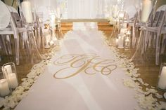 Custom Gold Monogram Aisle Runner |   Photography: Rob and Wynter Photography.   Read More:  http://www.insideweddings.com/weddings/mlb-players-white-black-gold-nye-ballroom-wedding-in-atlanta/806/