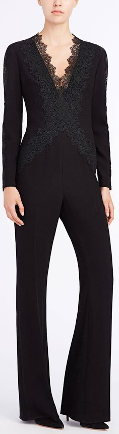The Willow crepe jumpsuit with flared pants and a plunging neckline.