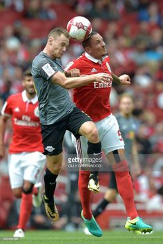 Leipzig's German striker Federico Palacios (L) vies with Benfica's Serbian midfielder Ljubomir Fejsa during the pre-season friendly football match between RB Leipzig and Benfica at The Emirates Stadium in north London on July 30, 2017, the game is one of four matches played over two days for the Emirates Cup. /